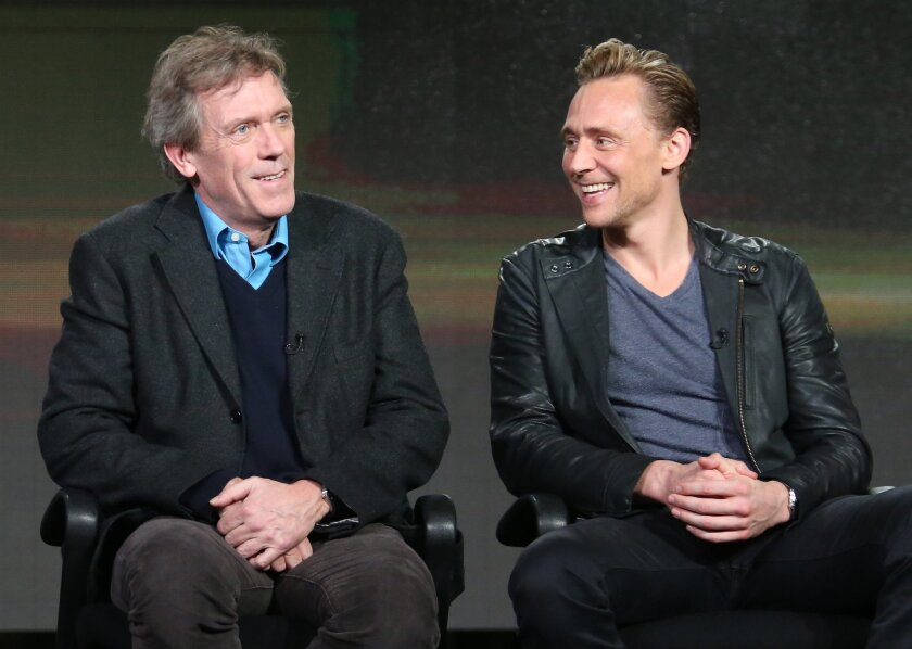 """Hugh Laurie, left, and Tom Hiddleston talk about their new miniseries, AMC's """"The Night Manager,"""" on Friday at the Television Critics Assn. press tour."""