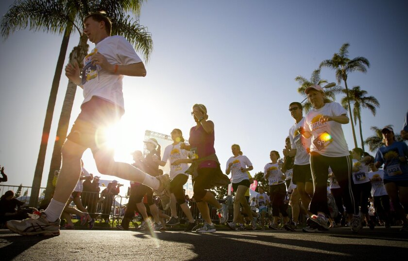 Runners and walkers begin the 5K course at the third annual Finish Chelsea's Run in honor of Chelsea King in Balboa Park Saturday morning.