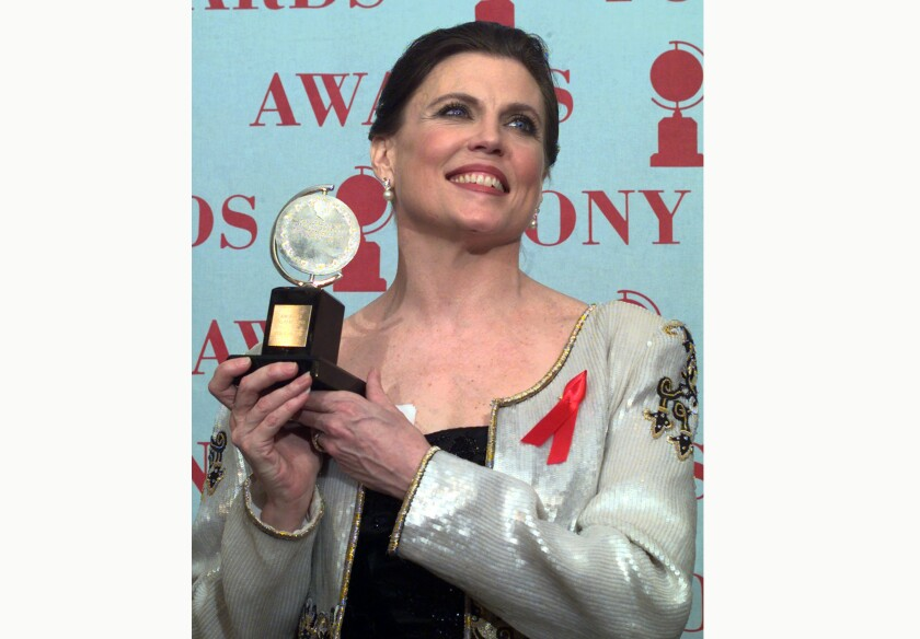 "FILE - Anne Reinking holds her Tony award for best choreography for the musical ""Chicago"" at the 51st annual Tony Awards on June 1, 1997, in New York. Reinking, the Tony Award-winning choreographer, actress and Bob Fosse collaborator who helped spread a cool, muscular hybrid of jazz and burlesque movement to Broadway and beyond, has died. She was 71. (AP Photo/Richard Drew, File)"