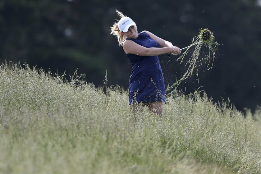 Sara Brown hits from the rough on the third hole of the second round of the ShopRite LPGA Classic golf tournament, Saturday, June 4, 2016, in Galloway Township, N.J. (AP Photo/Mel Evans)