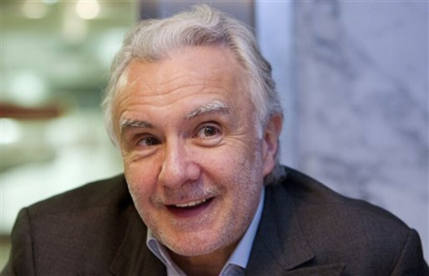 """French Chef Alain Ducasse reacts during an interview with the Associated Press, in Paris Wednesday June 8, 2011. The veteran cook admits his blood pressure is going up ahead of next month's royal wedding in Monaco, where he's to prepare a multi-course gala dinner for Prince Albert, his bride-to-be, Charlene Wittstock, and their 500 A-list guests. """"I've done gala dinners before, but never an official meal for a head of state. It's a first for me,"""" Ducasse told The Associated Press in an interview Wednesday, June 8, 2011. (AP Photo/Jacques brinon)"""
