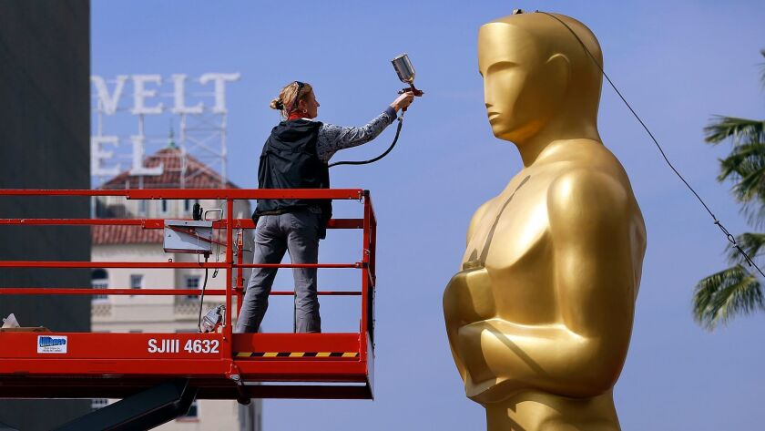 ABC will televise the 89th Academy Awards on Feb. 26 from the Dolby Theatre in Hollywood. Scenic artist Dena D'Angelo sprays gold paint to touch up the Oscar statue in 2015.
