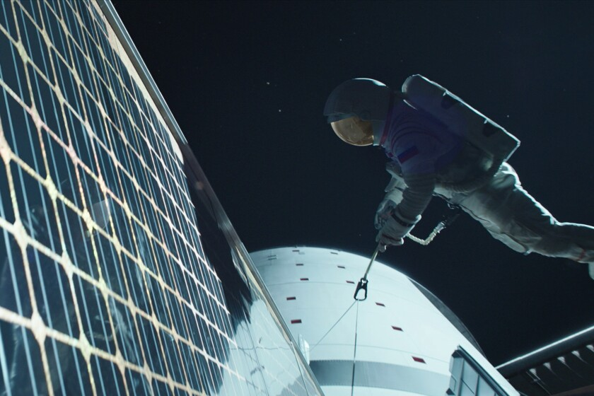 """An astronaut tethered to a ship in space in Netflix's """"Away."""""""
