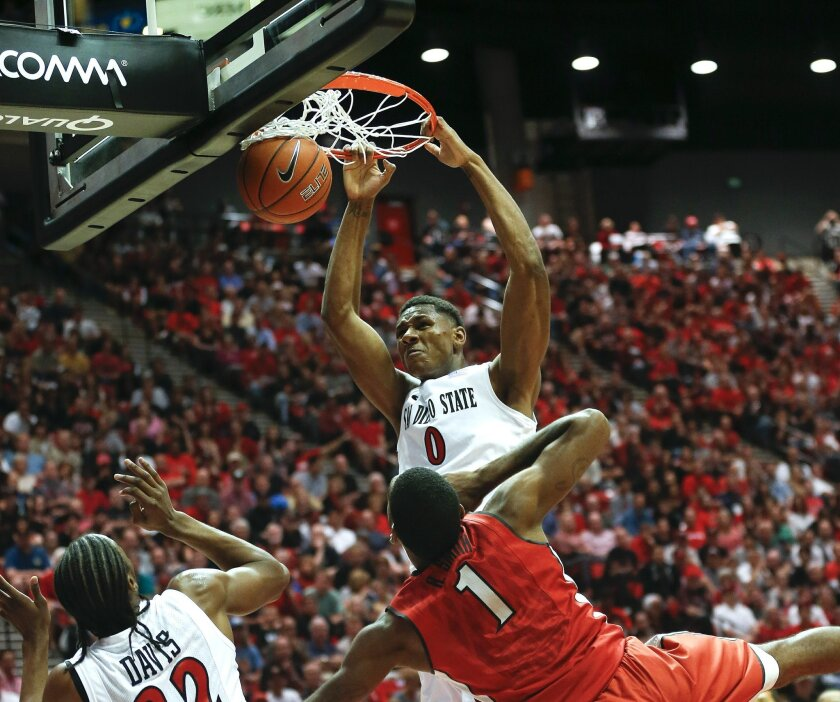 SDSU's Skylar Spencer dunks the ball as the Aztecs took on the UNLV Rebels at Viejas Arena Saturday afternoon.