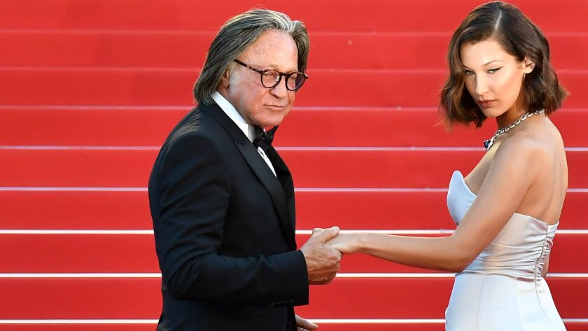 "Mohamed Hadid and his daughter Bella at the Cannes Film Festival in May as they arrived for the screening of ""Ismael's Ghosts."""