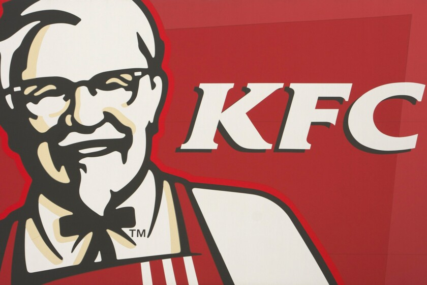 Melbourne, Australia - December 11, 2011: KFC (Kentucky Fried Chicken) logo on street billboard. KFC Corporation, founded and also known as Kentucky Fried Chicken, is a chain of fast food restaurants based in Louisville, Kentucky, in the United States.