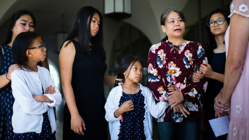 The family of Michael Phuong Minh Nguyen appears with Rep. Mimi Walters at a news conference Thursday. Nguyen, a U.S. citizen from Orange, has been detained by the Vietnamese government for nearly four weeks.