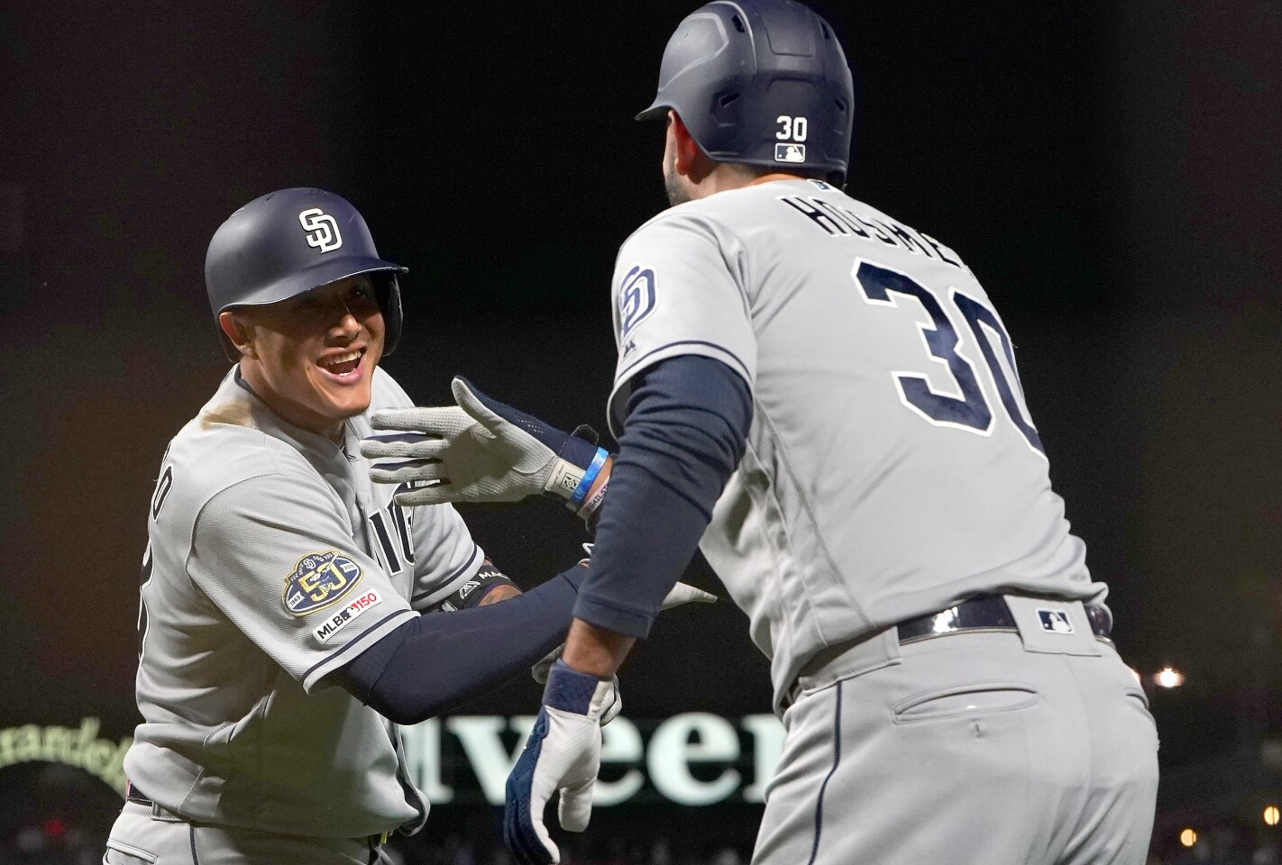 SAN FRANCISCO, CA - AUGUST 30: Manny Machado #13 of the San Diego Padres is congratulated by Eric Hosmer #30 after Machado hit a solo home run against the San Francisco Giants in the top of the fourth inning at Oracle Park on August 30, 2019 in San Francisco, California. (Photo by Thearon W. Henderson/Getty Images) ** OUTS - ELSENT, FPG, CM - OUTS * NM, PH, VA if sourced by CT, LA or MoD **