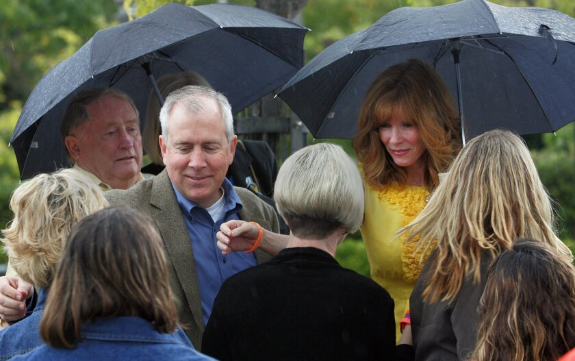Brent and Kelly King are greeted by supporters upon their arrival to the ceremony held for signing Chelsea's Law at the Balboa Park Organ Pavilion Thursday.