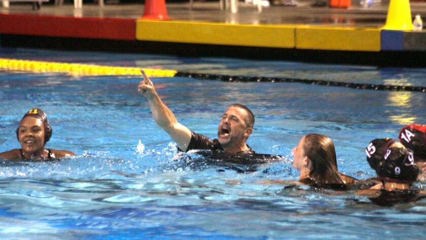 In an annual post-victory tradition, Bishop's School water polo coach Doug Peabody jumps into the pool to celebrate.