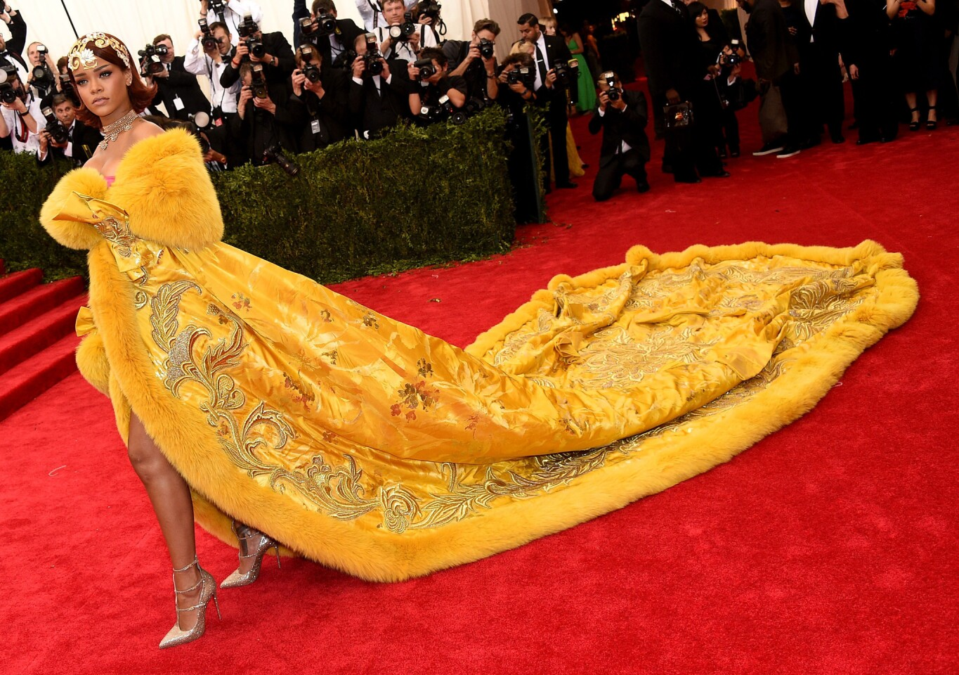 At the 2015 Met Gala, Rihanna's elaborate cape, made by Chinese designer Guo Pei, was so sweepingly huge that it required several train-handlers to help her down the red carpet.