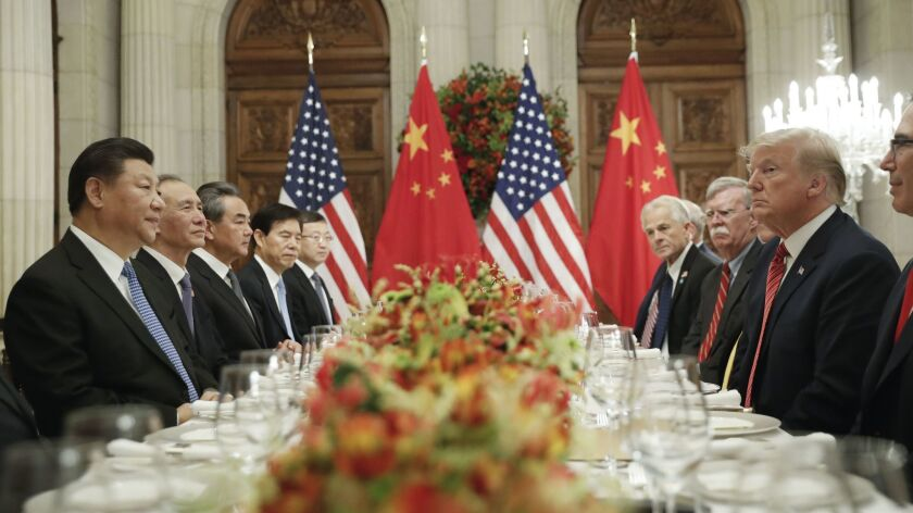 """President Trump with Chinese President Xi Jinping, left, during their meeting at the Group of 20 summit. Trump started a trade war in 2018, calling himself a """"tariff man."""""""
