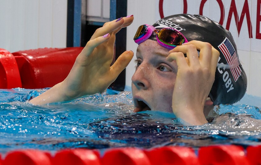 U.S. swimmer Lydia Jacoby celebrates after winning gold in the women's 100-meter breaststroke.