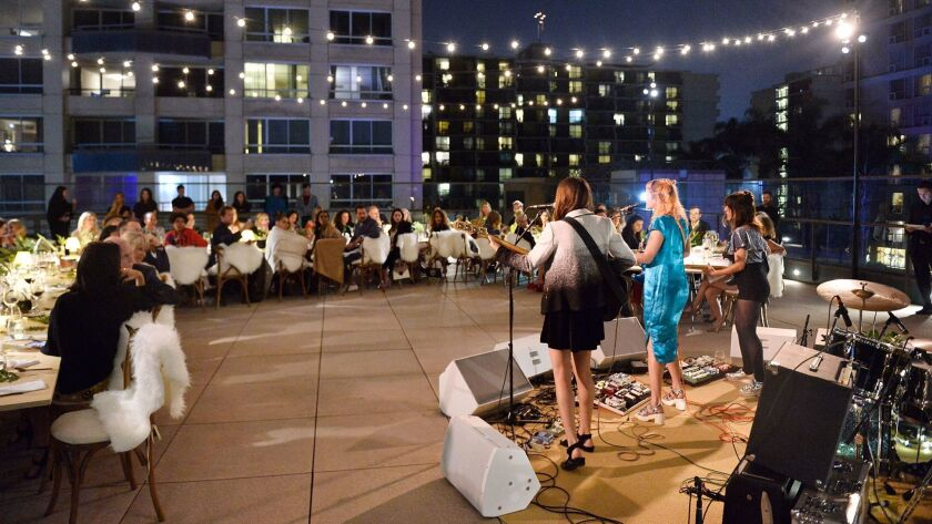 Winter performs at the Chloé x MOCA dinner on the museum's rooftop terrace in downtown Los Angeles.