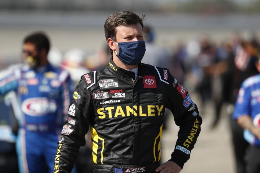 Erik Jones waits to enter his car before a NASCAR Cup Series auto race at Michigan International Speedway in Brooklyn, Mich., Saturday, Aug. 8, 2020. (AP Photo/Paul Sancya)