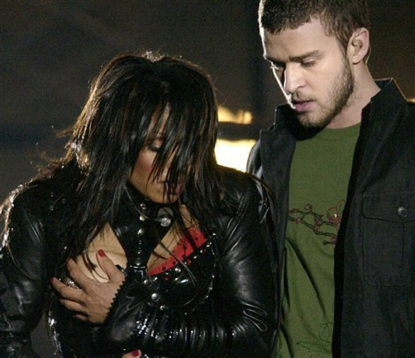 FILE - In this Sunday Feb. 1, 2004 file photo, entertainer Janet Jackson, left, covers her breast after her outfit came undone during the half time performance with Justin Timberlake at Super Bowl XXXVIII in Houston. The Supreme Court on Monday, May 4, 2009 ordered a federal appeals court to re-examine its ruling in favor of CBS Corp. in a legal fight over entertainer Janet Jackson's wardrobe malfunction. (AP Photo/David Phillip, File)