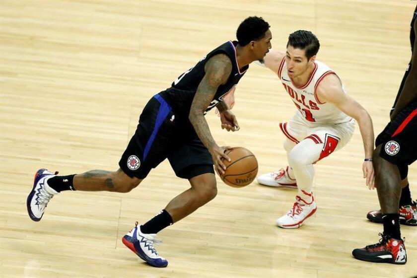 Los Angeles Clippers guard Lou Williams (L) in action against Chicago Bulls guard Ryan Arcidiacono (R) during an NBA basketball game between the Los Angeles Clippers and the Chicago Bulls at Staples Center in Los Angeles, California, USA, on March 15, 2019. EPA-EFE/ETIENNE LAURENT