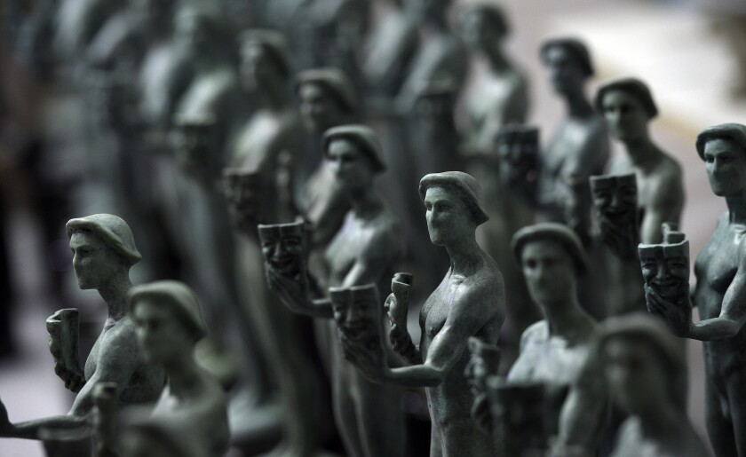 FILE - Finished Actor statuettes are displayed during the 25th annual Casting of the Screen Actors Guild Awards at American Fine Arts Foundry on Jan. 15, 2019, in Burbank, Calif. The 2022 SAG Awards will take place on Feb. 27. (Photo by Chris Pizzello/Invision/AP, File)
