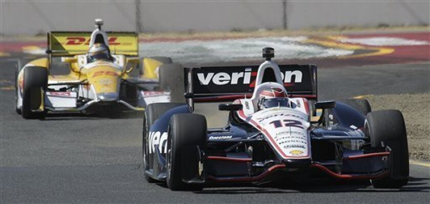 Will Power (12), of Australia, leads Ryan Hunter-Reay, of the United States, during practice for the IndyCar Series auto race Friday, Aug. 24, 2012, in Sonoma, Calif. (AP Photo/Ben Margot)