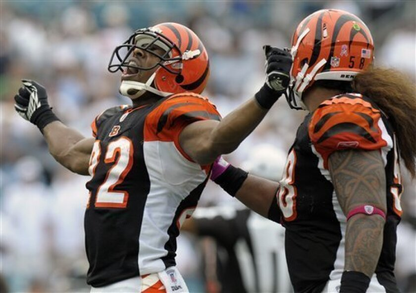 Cincinnati Bengals cornerback Nate Clements (22), left, celebrates and is congratulated by teammate Rey Maualuga after recovering a fumble by Jacksonville Jaguars quarterback Blaine Gabbert during the second half of an NFL football game in Jacksonville, Fla., Sunday, Oct. 9, 2011. The Bengals won 30-20. (AP Photo/Phelan M. Ebenhack)