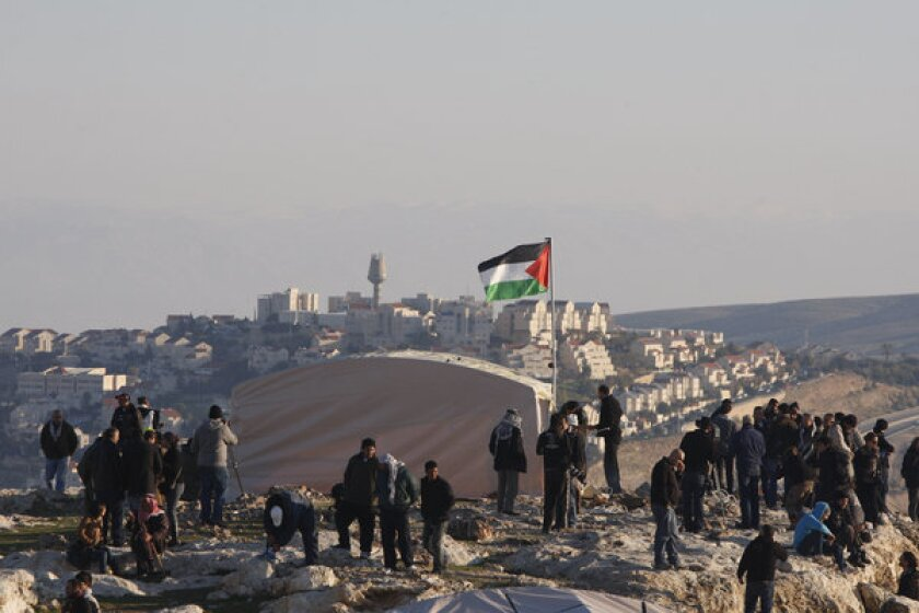 Activists protesting a planned Israeli development gather at a tent village before it was dismantled by Israeli police on Sunday.