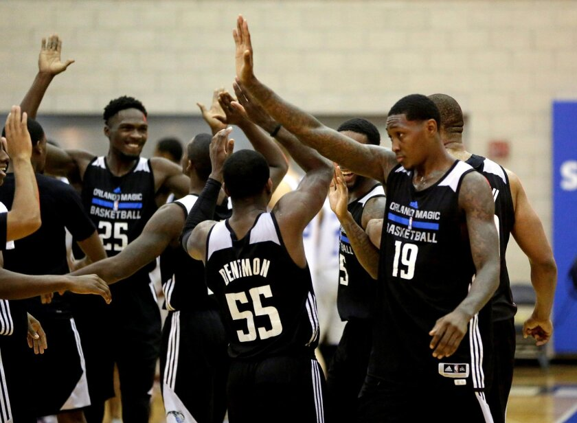 Orlando Magic White players celebrate after Justin Dentmon (55) made the game winning shot in overtime of an NBA summer league basketball game to defeat the Detroit Pistons 87-84, Friday, July 8, 2016, in Orlando, Fla. (AP Photo/John Raoux)