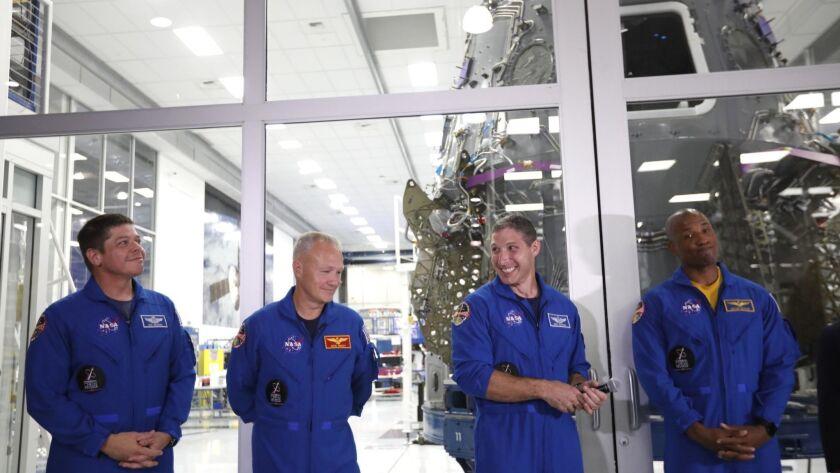 HAWTHORNE, CA - AUGUST 13, 2018 - NASA astronauts Bob Behnken, from left, Doug Hurley, Mike Hopkins