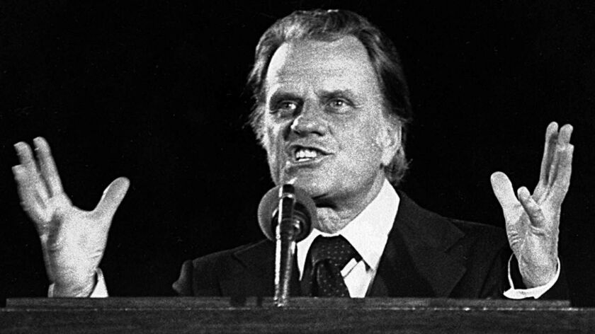 The Rev. Billy Graham addresses a crowd in Seattle during the Graham Crusade in 1976.
