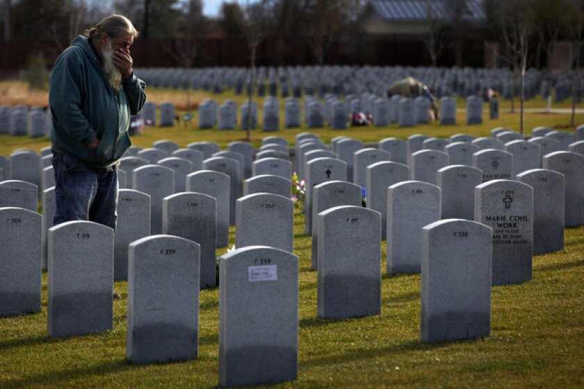 """Mark Tyree Sr. visits his son's grave. """"I grieve every day now,"""" he said. """"I don't want it to go away."""""""