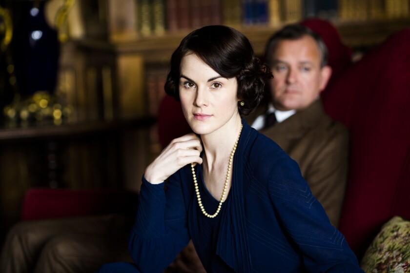 "Michelle Dockery and Hugh Bonneville in ""Downton Abbey"""