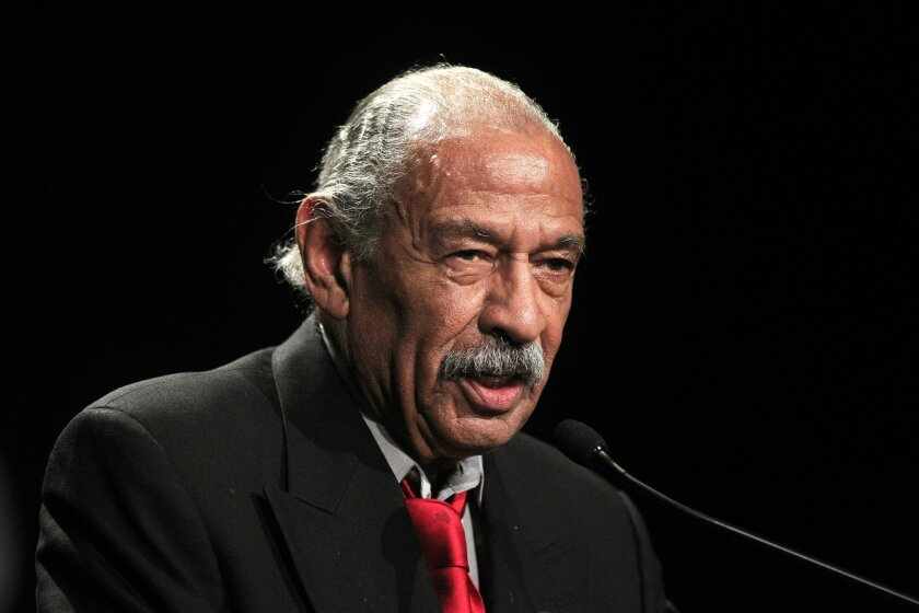 In this Nov. 6, 2012 photo, Rep. John Conyers, D-Mich., addresses supporters during the Michigan Democratic election night party in Detroit. Wayne County Clerk Cathy Garrett is expected to make her final determination Tuesday, May 13, 2014 on whether the longtime congressman should be on the Aug. 5