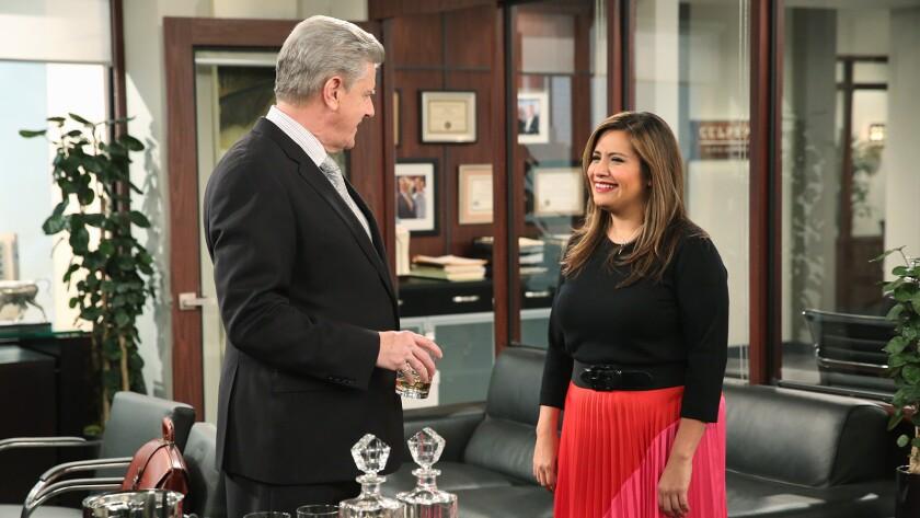 "Sam McMurray, Cristela Alonzo in ""Cristela"" on ABC."