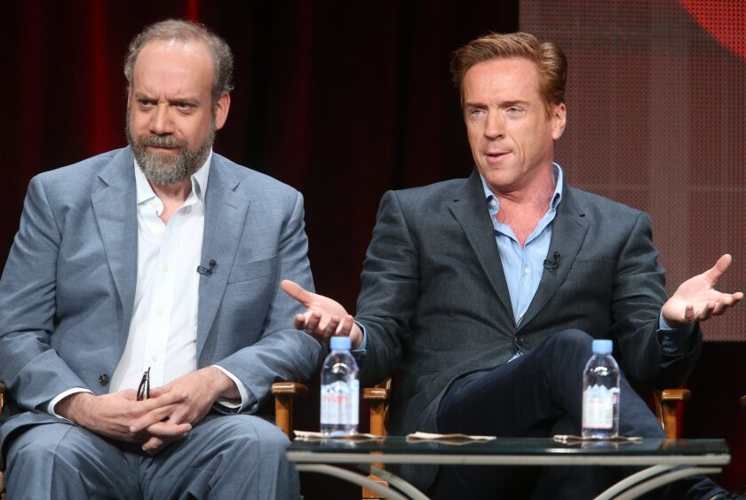 "Paul Giamatti, left, and Damian Lewis speak onstage during the ""Billions"" panel discussion at the Showtime portion of the 2015 Summer TCA Tour."