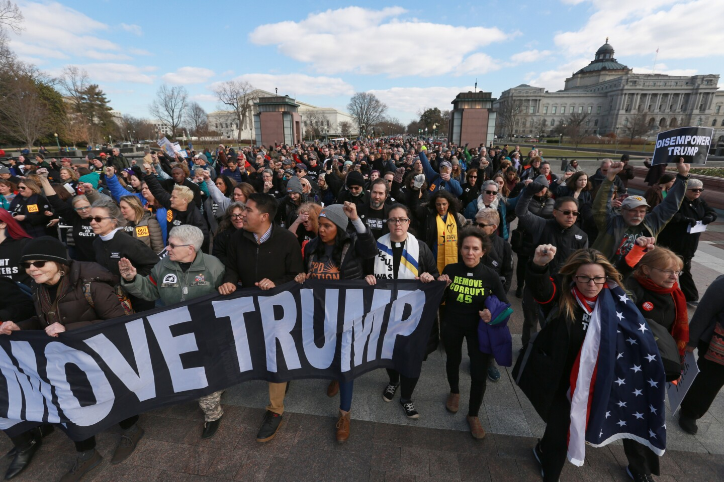 WASHINGTON, D.C., JANUARY 29, 2020: 400-500 Hundreds to Swarm the Capitol to Demand Witnesses and Evidence in Senate Impeachment Trial. Demonstrators protest outside of the Capitol during the Senate impeachment trial of President Donald Trump in Washington, Wednesday, Jan. 29, 2020. (Kirk McKoy/Los Angeles Times)
