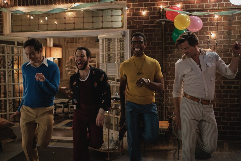 """Jim Parsons, Robin De Jesus, Michael Benjamin Washington and Andrew Rannells dance outside in """"The Boys in the Band."""""""