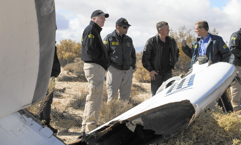 Investigators with the National Transportation Safety Board on Saturday survey the site where Virgin Galactic's SpaceShipTwo crashed in the Mojave Desert.