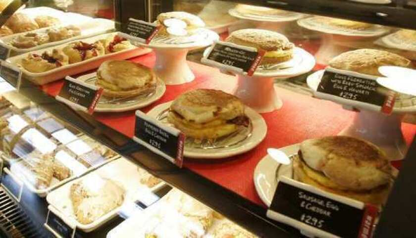Starbucks breakfast sandwiches at a store in Seattle. The cafe giant will spend $100 million to buy the La Boulange Bakery brand.