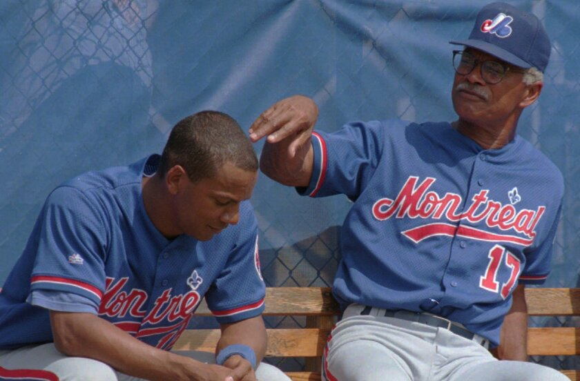 Montreal Expos manager Felipe Alou speaks with his son, Moises
