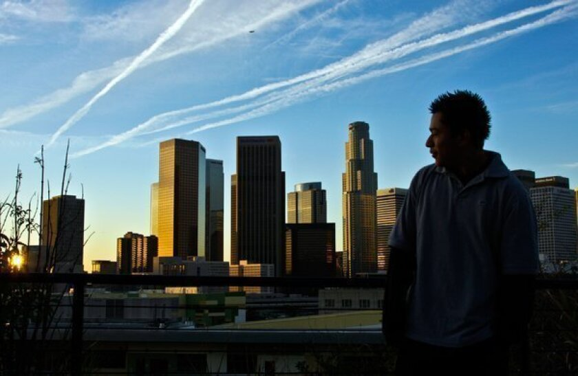 The L.A. skyline appears in the background of this file photo shot from Vista Hermosa Park in Echo Park.