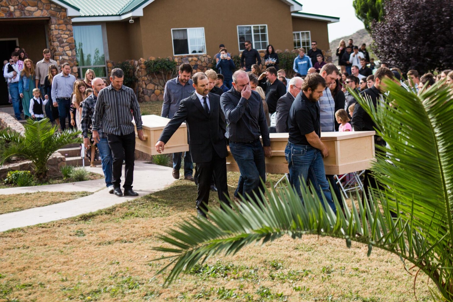 The coffins of Dawna Langford and two of her sons, Trevor and Rogan, are carried out for their funeral Thursday in La Mora, Mexico, Thursday, Nov. 7, 2019. The three were among the nine Mormons killed in Monday's attack.