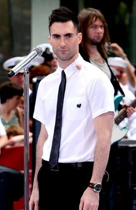 "The short-sleeve, button-front shirt is coming back into play this summer, with designer labels adding their own spin to the often-derided men's shirt. Here, Maroon 5 frontman Adam Levine sports a coolly ironic look created by L.A. stylist Aristotle Circa for a ""Today Show"" performance last summer. Levine, who called it his ""Falling Down"" look (from the 1993 Michael Douglas movie), rocked a white, short-sleeve button-front by APC, skinny black tie by Dior Homme and black YSL trousers. More... • How to wear short-sleeve, button-up shirts for summer Also in Image • Tory Burch's classic looks • Che: Man, myth, logo"