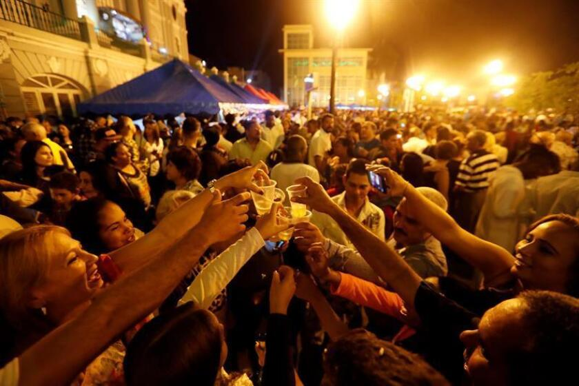The city of Santiago in eastern Cuba, known as the Cradle of the Revolution, celebrates Tuesday, Jan. 1, 2019, amid the aroma of barbecued pork and the music of New Year's partying, the 60 years gone by since the victory of Fidel Castro's rebels. EFE-EPA/Ernesto Mastrascusa