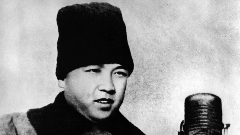 FILE - In this February 1948, file photo released by the North Korean government, Kim Il Sung attend