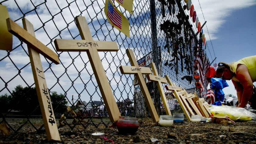 PRESCOTT , AZ., JULY 2, 2013: Nineteen crosses lean against the fence surrounding the headquarters a