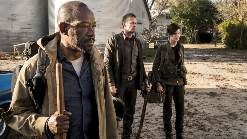 """The Walking Dead's"" Lennie James as Morgan Jones, left, joins the season-four ""Fear the Walking Dead"" cast, which includes Garret Dillahunt as John, center, and Maggie Grace as Althea."