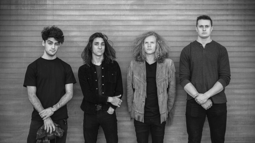 Joyous Wolf, an O C -based rock band, signs a major-label