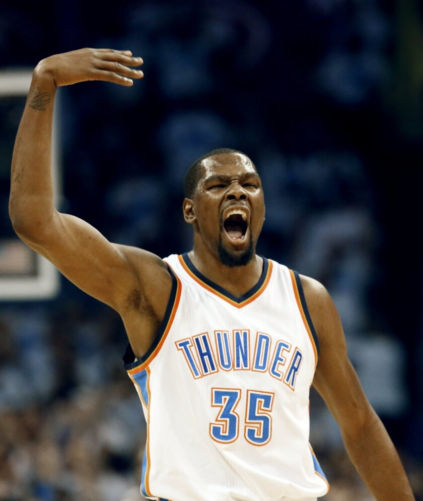 Oklahoma City Thunder forward Kevin Durant (35) celebrate against the Golden State Warriors during the first quarter in Game 3 of the NBA basketball Western Conference finals  in Oklahoma City, Sunday, May 22, 2016. (AP Photo/Sue Ogrocki)