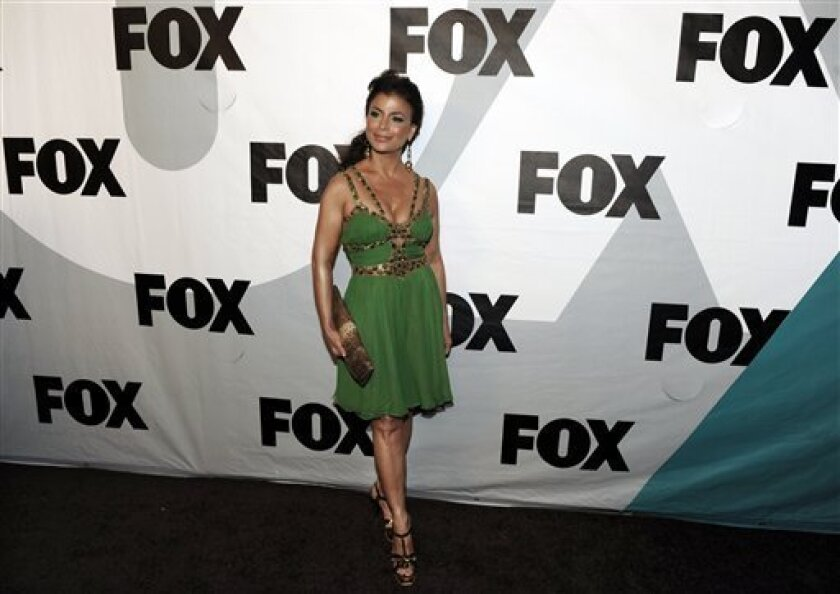 """Paula Abdul of """"American Idol"""" arrives at the FOX Winter All-Star Party in Los Angeles, Tuesday, Jan. 13, 2009. (AP Photo/Chris Pizzello)"""