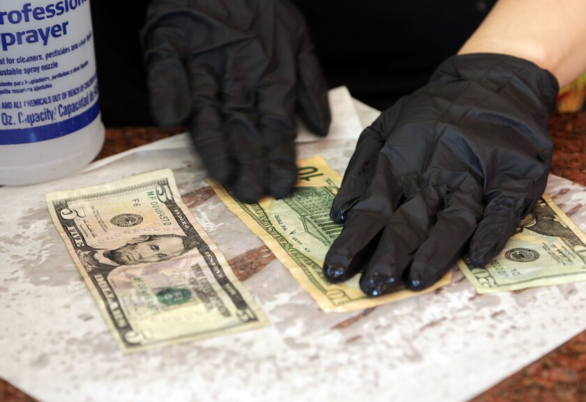 Disinfecting cash