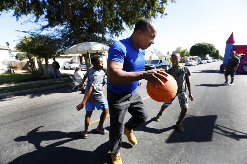 INGLEWOOD, CA SEPTEMBER 29, 2018: Inglewood Mayor James T. Butts, middle, plays basketball for a f